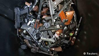 Hand guns that were turned in by their owners are seen in a trash bin at a gun buyback held by the Los Angeles Police Department following the mass shooting at Sandy Hook Elementary School in Connecticut, in Los Angeles, California, December 26, 2012. The program normally occurs in May but Los Angeles mayor Antonio Villaraigosa accelerated the schedule in response to the December 14 shooting that left 20 children and six adults dead, along with the gunman, and caused a national outcry against gun violence. People can anonymously trade in their guns, no questions asked, for $200 grocery store gift cards for automatic weapons and $100 gift cards for shotguns, handguns and rifles. REUTERS/David McNew (UNITED STATES - Tags: SOCIETY TPX IMAGES OF THE DAY)