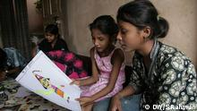 One child contributor of the brothel magazine Jugnu is showing her drawing to another child contributor. They all are children of prostitutes. (Photo: Aziz Rahman / DW)