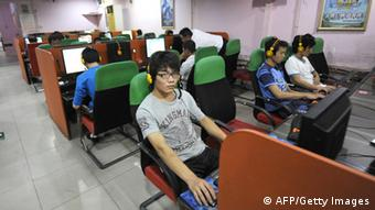 A young man uses a computer at an Internet bar in Beijing on September 8, 2011. Beijing has moved to stem a tide of online criticism by tightening its grip on China's hugely popular microblogs, but experts say it will struggle to control the country's online masses. AFP PHOTO / LIU JIN (Photo credit should read LIU JIN/AFP/Getty Images)