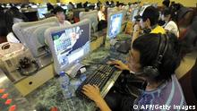People use computers at an internet bar in Beijing on June 3, 2009. Chinese web users are claiming a temporary victory against censorship after taking up the case of a young woman accused of murdering a local official who she says tried to force himself on her. In what has rapidly become the hottest topic on the Internet, chatroom users and blogs have lionised 22-year-old Deng Yujiao as a heroine for fighting back against what they say is China's over-bearing and corrupt bureaucracy. AFP PHOTO/LIU Jin (Photo credit should read LIU JIN/AFP/Getty Images)