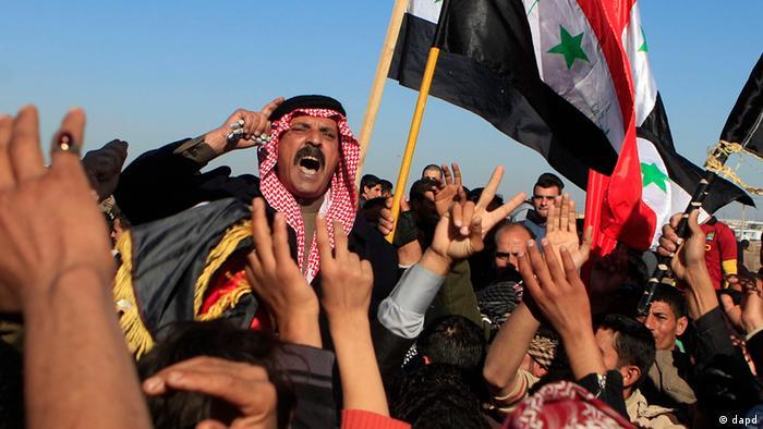 Protesters chant slogans against Iraq's Shiite-led government (Photo:Karim Kadim/AP/dapd)