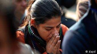A woman cries while attending a gathering of people who came together to mourn the death of the 23-year-old gang rape victim in New Delhi, India, Saturday, Dec. 29, 2012. The young Indian woman who was gang-raped and severely beaten on a bus in New Delhi died Saturday at a Singapore hospital, after her ordeal galvanized Indians to demand greater protection for women from sexual violence that impacts thousands of them every day. (AP Photo/ Saurabh Das)