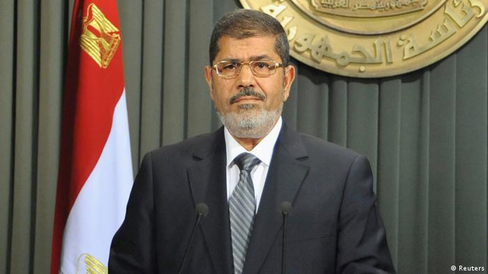 Egypt's President Mohamed Mursi speaks to the nation after signing Egypt's new constitution in Cairo December 26, 2012, in this handout photo released by Egyptian Presidency office. Mursi signed into law a new constitution shaped by his Islamist allies, a bitterly contested document which he said would help end political turmoil and allow him to focus on fixing the economy. REUTERS/Egyptian Presidency/Handout (EGYPT - Tags: POLITICS ELECTIONS) FOR EDITORIAL USE ONLY. NOT FOR SALE FOR MARKETING OR ADVERTISING CAMPAIGNS. THIS IMAGE HAS BEEN SUPPLIED BY A THIRD PARTY. IT IS DISTRIBUTED, EXACTLY AS RECEIVED BY REUTERS, AS A SERVICE TO CLIENTS