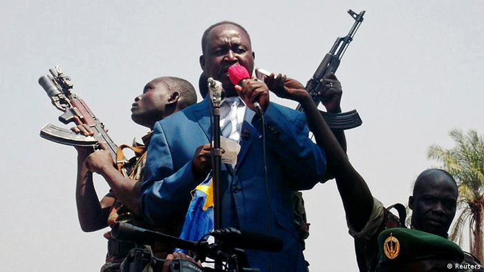 Central African Republic President Francois Bozize, center, speaks to a crowd of supporters and anti-rebel protesters during an appeal for help, in Bangui, on December 27, 2012. (REUTERS/Stringer)