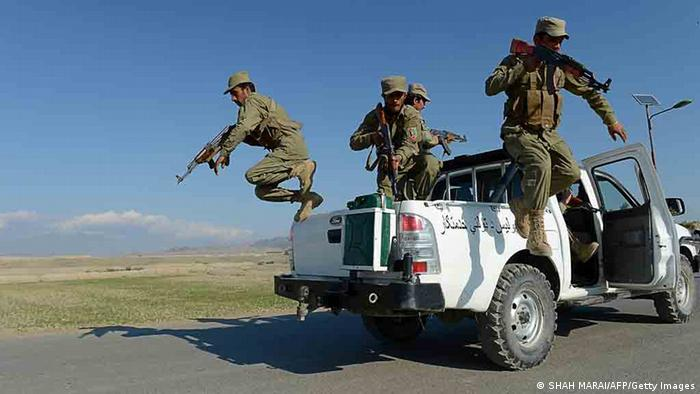 TO GO WITH Afghanistan-unrest-police-by Joris Fioriti In this photograph taken on December 18, 2012, Afghan Local police personnel jump from their vehicle as they train (SHAH MARAI/AFP/Getty Images)