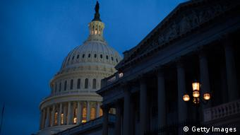 WASHINGTON, DC - DECEMBER 31: The U.S. Capitol illuminates at dusk on Capitol Hill on December 31, 2012 in Washington, DC. The House and Senate are both still in session on New Year's Eve to try to deal with the looming 'fiscal cliff' issue. (Photo by Drew Angerer/Getty Images)