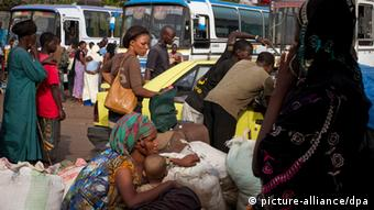 FILE - Malian families arriving in the Bamako bus station waiting to receive their possessions after a long journey from Timbuktu, northern Mali, on 11 April 2012. The MNLA, a Tuareg seperatist rebel group, and Ansar Dine, another rebel group wishing to impose Sharia Law upon Mali, have both claimed occupation of Timbuktu and other cities in Northern Mali, prompting many to flea the region. EPA/Tanya Bindra (Zu dpa KORR Afrika vor turbulentem 2013: Kampfzonen im Sahel und Zentralafrika) pixel