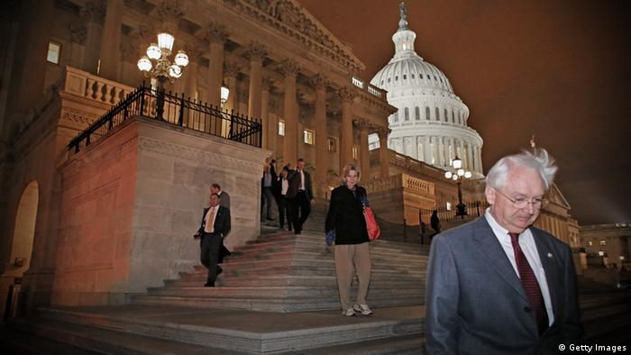 Members of the House of Representatives leave after voting for legislation to avoid the fiscal cliff