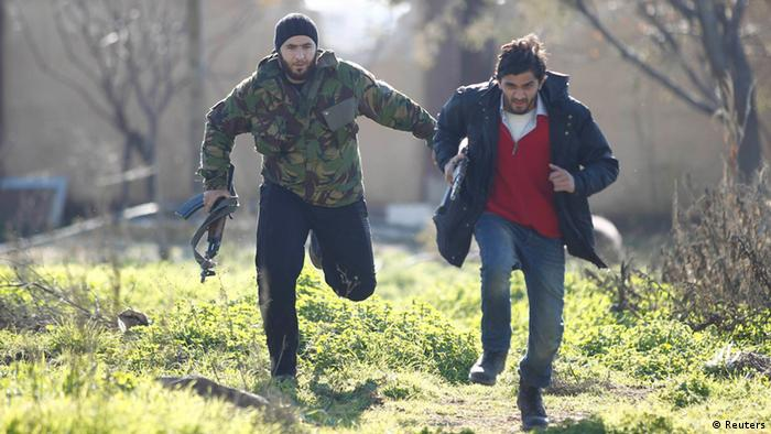 Free Syrian Army fighters run for cover at the front line near Menagh military airport in north Aleppo December 31, 2012. Picture taken December 31, 2012. REUTERS/Abu Muhammad Al-Azazi/Shaam News Network/Handout (SYRIA - Tags: POLITICS CIVIL UNREST TPX IMAGES OF THE DAY) FOR EDITORIAL USE ONLY. NOT FOR SALE FOR MARKETING OR ADVERTISING CAMPAIGNS. THIS IMAGE HAS BEEN SUPPLIED BY A THIRD PARTY. IT IS DISTRIBUTED, EXACTLY AS RECEIVED BY REUTERS, AS A SERVICE TO CLIENTS