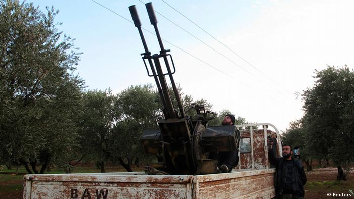 Free Syrian Army fighters with artillery near the airbase (Photo: REUTERS/Abdalghne Karoof)