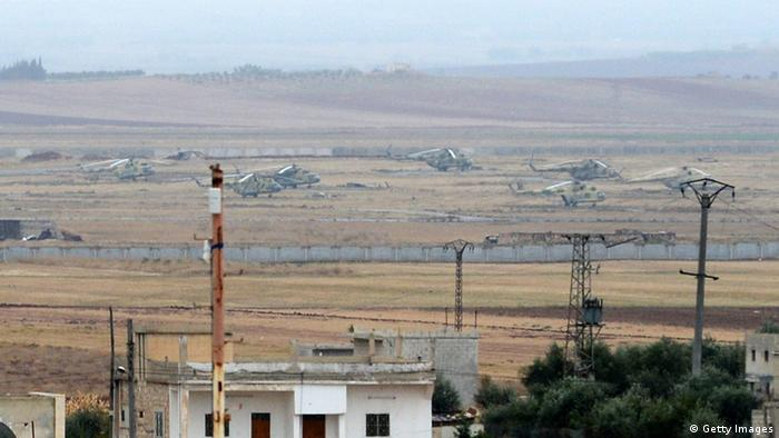 Syrian government forces' helicopters are parked at a military base near the northern Syrian town of Taftanaz, in the Idlib province, on November 9, 2012. (Photo: PHILIPPE DESMAZES/AFP/Getty Images)