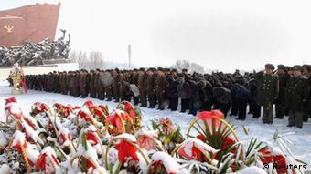 North Koreans pay their respects. North's official KCNA news agency. REUTERS/KCNA (NORTH KOREA