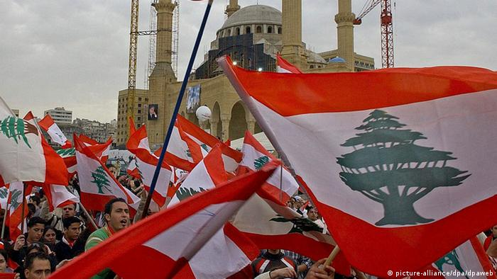 Lebanese protestors wave the national flags in Beirut, March 2005 (Photo: Nabil Mounizer)