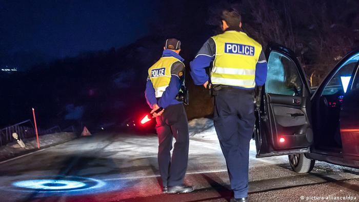 Swiss police close off the road to Daillon after three people were shot dead in Daillon, Switzerland. (EPA/OLIVIER MAIRE)