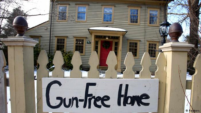 A Gun-FreeHome sign is seen in front of a house