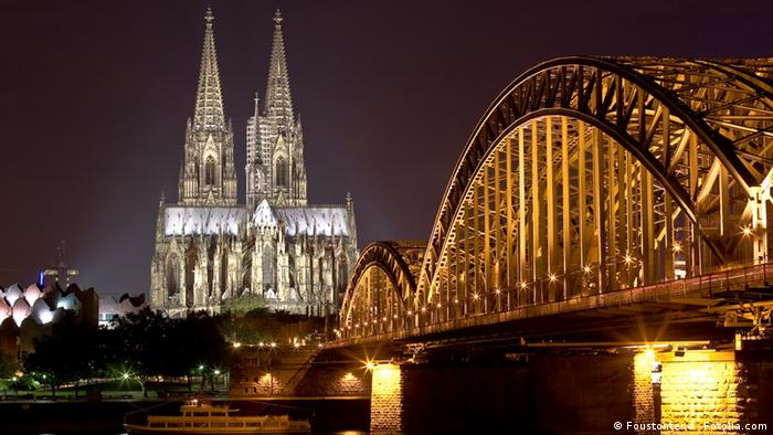 A photograph of Cologne Cathdral at night.