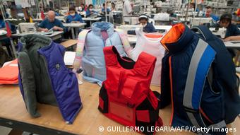 A variety of multi-colored vests stand in display on a table (Photo: GUILLERMO LEGARIA/AFP/Getty Images)