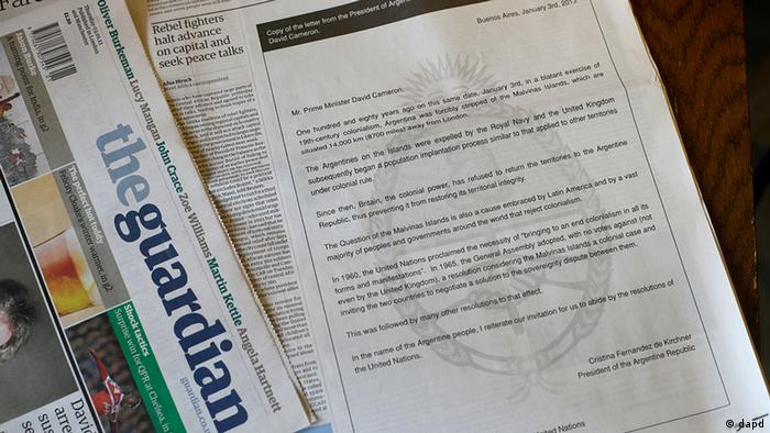 In this photo-illustration a copy of the British national newspaper The Guardian shows an open letter published as an advertisement from the President of Argentina Cristina Fernandez de Kirchner to the British Prime Minister David Cameron about the Falkland Islands, called the Malvinas Islands by Argentina. It was published in London on Thursday, January 3, 2013. (Photo via AP)