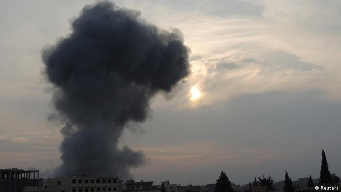 Smoke rises after what activists said were missiles fired by a Syrian Air Force fighter jet loyal to President Bashar al-Assad in Binsh near Idlib January 2, 2013.