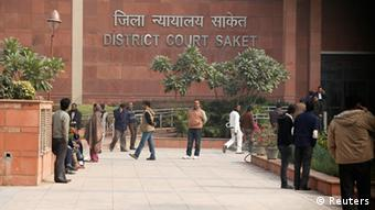 People arrive at a district court in New Delhi January 3, 2013.
