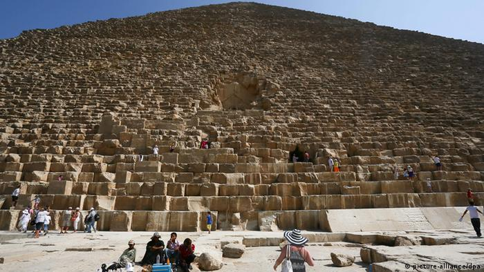 Foreign tourists in front of the great Pyramids in Egypt