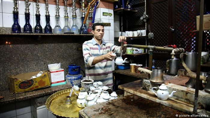 epa02359828 One of the staff members prepares tea at al-Fishawi cafe in Khan al-Khalili bazaar, Cairo, Egypt, 26 September 2010. Al-Fishawi is Egypt's most famous coffee shop and used to be a favourite haunt of artists and writers such as late Nobel prize-winning author Naguib Mahfouz. The cafe claims to have been open 24 hours a day, seven days a week for about 200 hundred years. It is also called the 'cafe of mirrors' and it is placed along the side of one of Khan al-Khalili bazaar's narrow alleyways. It is visited by a mix of tourists, locals, shop-keepers and street-sellers and retains an atmosphere of an old times Cairo. EPA/AMEL PAIN