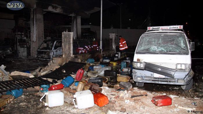 Wreckage and debris are seen after a car bomb exploded at a crowded petrol station in Barzeh al-Balad district in Damascus, in this handout photograph released by Syria's national news agency SANA on January 3, 2013. At least 11 people were killed and 40 wounded in the explosion, opposition activists said.
