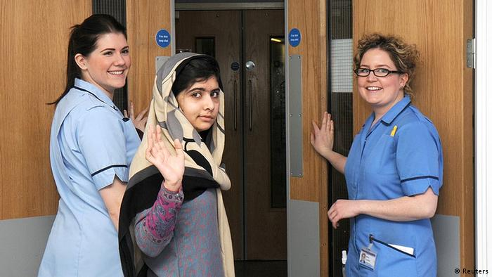 Pakistani schoolgirl Malala Yousufzai (C) waves with nurses as she is discharged from The Queen Elizabeth Hospital in Birmingham in this handout photograph released on January 4, 2013.