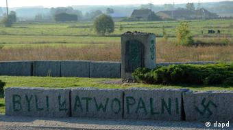 An inscription reading They were Flammable and a Nazi swastika are seen in Jedwabne, Poland