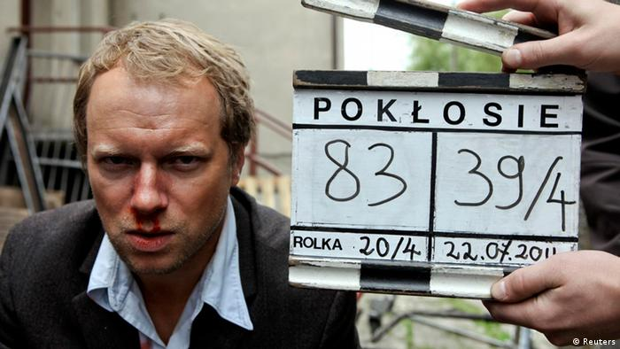 Polish actor Maciej Stuhr looks into a camera on set of the movie Poklosie (Aftermath) near Warsaw