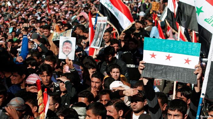 Source News Feed: EMEA Picture Service ,Germany Picture Service Iraqi Sunni Muslims take part in an anti-government demonstration in Falluja, 50 km (30 miles) west of Baghdad, December 28, 2012. Tens of thousands of protesters from Iraq's Sunni Muslim minority poured onto the streets after Friday prayers in a show of force against Shi'ite Prime Minister Nuri al-Maliki, keeping up a week-old blockade of a highway. Around 60,000 people blocked the main road through the city of Falluja, setting fire to the Iranian flag and shouting out, out Iran! Baghdad stays free and Maliki you coward, don't take your advice from Iran. Many Sunnis, whose community dominated Iraq until the fall of Saddam Hussein in 2003, accuse Maliki of refusing to share power and of favouring Shi'ite, non-Arab neighbour Iran. REUTERS/Thaier Al-Sudani (IRAQ - Tags: POLITICS CIVIL UNREST)