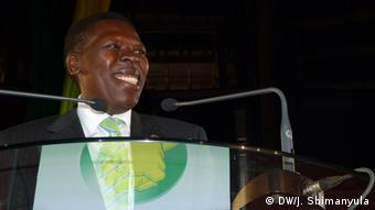 Eugene Wamalwa addresses public infront of a microphone