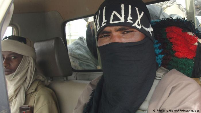 An Ansar Dine fighter wearing a black scarf covering most of his face