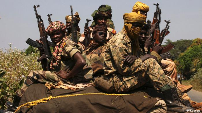 Source News Feed: EMEA Picture Service ,Germany Picture Service Soldiers from the Chadian contingent of the Central African Multinational Force (FOMAC) hold their weapons as they patrol in Damara, about 75 km (46 miles) north of Bangui January 2, 2013. Rebels in Central African Republic said they had halted their advance on the capital on Wednesday and agreed to start peace talks, averting a clash with regionally backed troops in the mineral-rich nation. REUTERS/Luc Gnago (CENTRAL AFRICAN REPUBLIC - Tags: MILITARY CIVIL UNREST POLITICS)