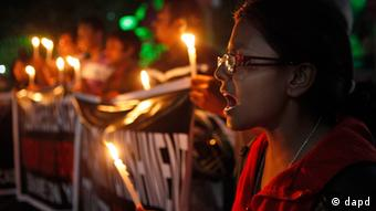 Students shout slogans during a candlelight vigil protesting against a leader of the ruling Congress party on accusations he raped a woman in a village in the early hours of the morning, in Gauhati, India, Friday, Jan. 4, 2013. (Photo: AP)