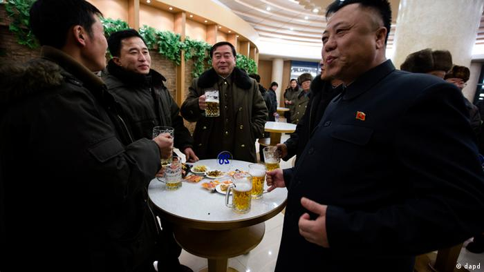 North Korean men drink beer at the Mansugyo Soft Drink restaurant in Pyongyang, North Korea, Thursday, Dec. 20, 2012. North Korean leader Kim Jong Un ordered the reconstruction of the restaurant that stood for decades along the Taedong river. The restaurant specialises in seven flavours of beer, cocktails, coffee and snack food. Photo: AP/Ng Han Guan