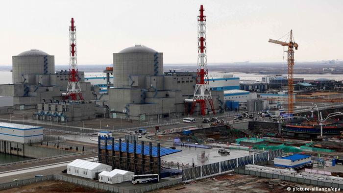 The Phase II project of the Tianwan Nuclear Power Plant is under construction in Lianyungang city, east Chinas Jiangsu province, 27 December 2012. Beijing suspended approval of new nuclear power projects following the massive earthquake and tsunami in March 2011, that triggered a radiation leak at Japans Fukushima Daiichi nuclear power plant. But now Chinas nuclear program is getting back on track. The Ministry of Environmental Protection heralded this development in late November with two announcements: The Qinshan Nuclear Power Plant in east Chinas Zhejiang province will launch a flood-control project, and the Tianwan Nuclear Power Plant in Jiangsu province, also in east China, will build two nuclear power reactor units. The State Council passed the Nuclear Power Safety Plan (2011-20) and the Mid- and Long-Term Development Plan for Nuclear Power (2011-20) on October 24. Eight days earlier, it approved the 12th Five-Year Plan (2011-15) for Nuclear Safety and Radioactive Pollution Prevention and Vision for 2020. These three documents paved the way for the nation to relaunch its nuclear power projects. Fifteen nuclear power reactors had entered service by the end of 2011, with a total installed capacity of 12.54 million kilowatts. Another 26, still under construction, were designed with a combined installed capacity of 29.24 million kW, the largest in the world. The countrys installed nuclear power capacity is expected to reach 40 million kW by 2015, according to Chinas Energy Policy 2012 published by the Information Office of the State Council on October 24.