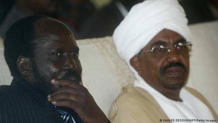 KHARTOUM, SUDAN: Leader of the Sudan People's Liberation Movement (SPLM), Salva Kiir (L), sits next to Sudanese President Omar al-Bashir at a low-key ceremony in Khartoum 11 August 2005, during which Kiir was sworn in as Sudan's first vice president after the death of his predecessor John Garang. Kiir, 54, pledged to follow his legacy and work for peace and unity in the war-ravaged country. He took office less than two weeks after Garang was killed in a helicopter crash that raised fears for the future of a peace deal that ended 21 years of war between southern rebels and the government in Khartoum. AFP PHOTO/KHALED DESOUKI (Photo credit should read KHALED DESOUKI/AFP/Getty Images)