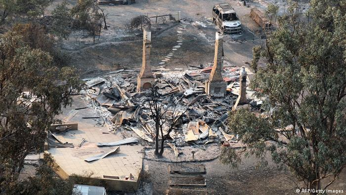 This aerial photograph taken on January 5, 2013 shows the devastated town of Dunalley after bush fires swept through the area. Thousands of people have fled wildfires raging on the Australian island of Tasmania that have destroyed at least 80 properties amid fears that at least one man died in the blaze, police said. AFP PHOTO / POOL / Chris Kidd (Photo credit should read Chris Kidd/AFP/Getty Images)