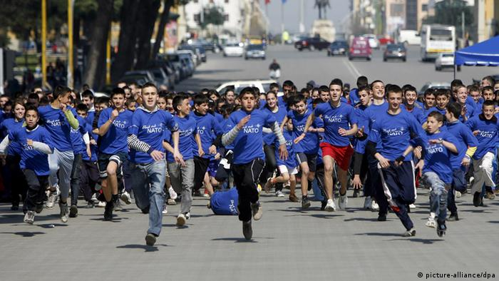 Albanian children take part in a marathon entitled 'Me and NATO' organized by the Albanian Parliament in Tirana, Albania, 23 March 2009. Albania will soon join the NATO Alliance as a full member at its summit in Strasbourg/Kehl in early April 2009.