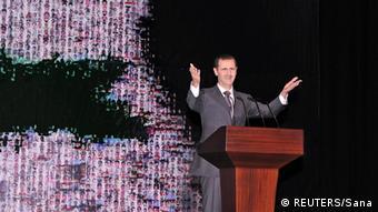 Asad za govornicom