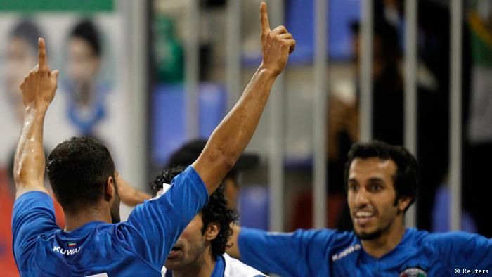 Kuwait's Bader Al-Mutawa celebrates with teammates after scoring against Yemen during their Gulf Cup tournament soccer match in Isa Town January 6, 2013. REUTERS/Mohammed Dabbous (BAHRAIN - Tags: SPORT SOCCER)