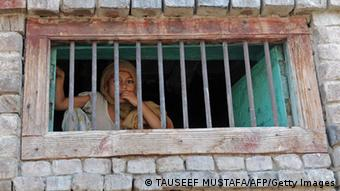 A Kashmiri girl behind an open window watches during an anti Indian protest in Srinagar on August 19, 2010.(Photo: TAUSEEF MUSTAFA/AFP/Getty Images)