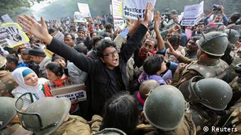 Demonstrators shout slogans as they are surrounded by the police during a protest rally in New Delhi in this December 27, 2012 file photo. It's no surprise the Indian street wants faster, harsher justice for sexual crimes after a horrific gang rape that rocked the nation, but some activists worry the government will trample fundamental rights in its rush to be in tune with popular rage. Last month's rape of a physiotherapy student on a moving bus and her death on December 28, 2012 in hospital triggered a national debate about how to better protect women in India, where official data shows one rape is reported on average every 20 minutes. REUTERS/Adnan Abidi/Files (INDIA - Tags: CRIME LAW POLITICS)