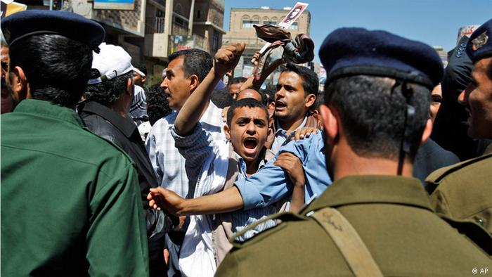 An anti-government protester shouts slogans at Yemeni police during a demonstration against President Ali Abdullah Saleh in Sanaa. 15.02.2011