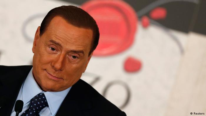 Former Italian Prime Minister Silvio Berlusconi reacts during a book launch of his friend, TV presenter Bruno Vespa, in Rome December 12, 2012. REUTERS/Alessandro Bianchi (ITALY - Tags: POLITICS ENTERTAINMENT)