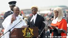 Ghana's President John Dramani Mahama (L) takes an oath of office, next to Ghana's Chief Justice Georgina Wood (R), at the Independence Square, in Accra, on January 7, 2013. Mahama was sworn in as president today at a ceremony attended by thousands in the capital but boycotted by the opposition, which has challenged the election results. Mahama, who initially became head of state following the death of his predecessor John Atta Mills in July, pledged to build on the west African nation's economic success in a speech after taking the oath. AFP PHOTO / PIUS UTOMI EKPEI (Photo credit should read PIUS UTOMI EKPEI/AFP/Getty Images)