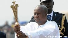 Ghanaian President John Mahama raises the staff of office after swearing to an oath of office at the Independence Square, Accra in January 7. 2013. Ghanaian President John Dramani Mahama has been sworn-in into office despite a court challenge by the main opposition New Patriotic party, citing alleged voting fraud resulting in the absence of party officials at the swearing-in ceremony attended by nine heads of state. AFP PHOTO/PIUS UTOMI EKPEI (Photo credit should read PIUS UTOMI EKPEI/AFP/Getty Images)