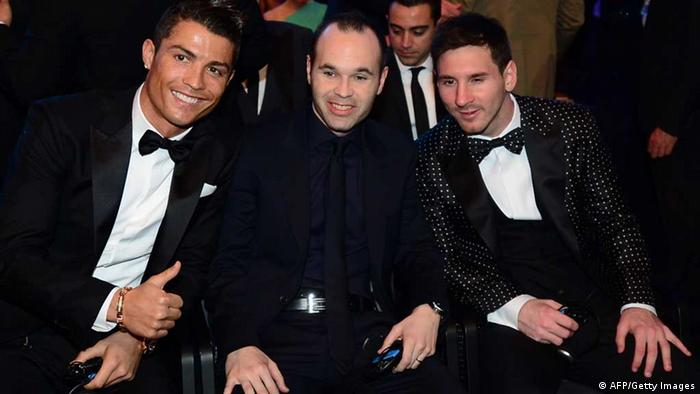 Ballon d'Or finalists (L-R) Real Madrid's Portuguese forward Cristiano Ronaldo, Barcelona's Spanish midfielder Andres Iniesta and Barcelona's Argentinian forward Lionel Messi pose prior to the start of the FIFA Ballon d'Or awards ceremony at the Kongresshaus in Zurich on January 7, 2013. AFP PHOTO / OLIVIER MORIN (Photo credit should read OLIVIER MORIN/AFP/Getty Images)