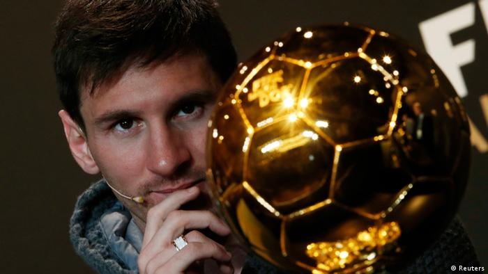 FIFA Men's Ballon d'Or of the Year 2012 nominee Lionel Messi of Argentina watches the trophy during a news conference before the FIFA Ballon d'Or 2012 soccer awards ceremony at the Kongresshaus in Zurich January 7, 2013. REUTERS/Michael Buholzer (SWITZERLAND - Tags: SPORT SOCCER)